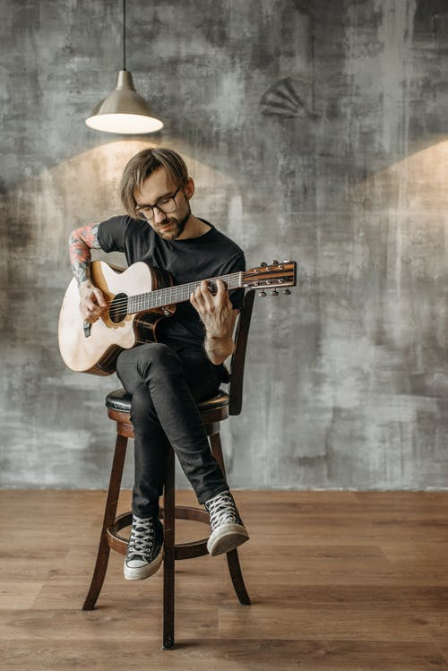 A Man Playing Acoustic Guitar