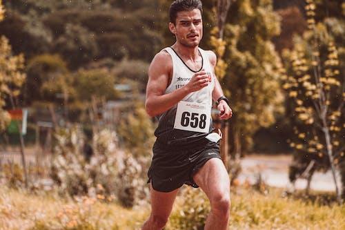 Selective Focus Shot of a Man Running a Marathon