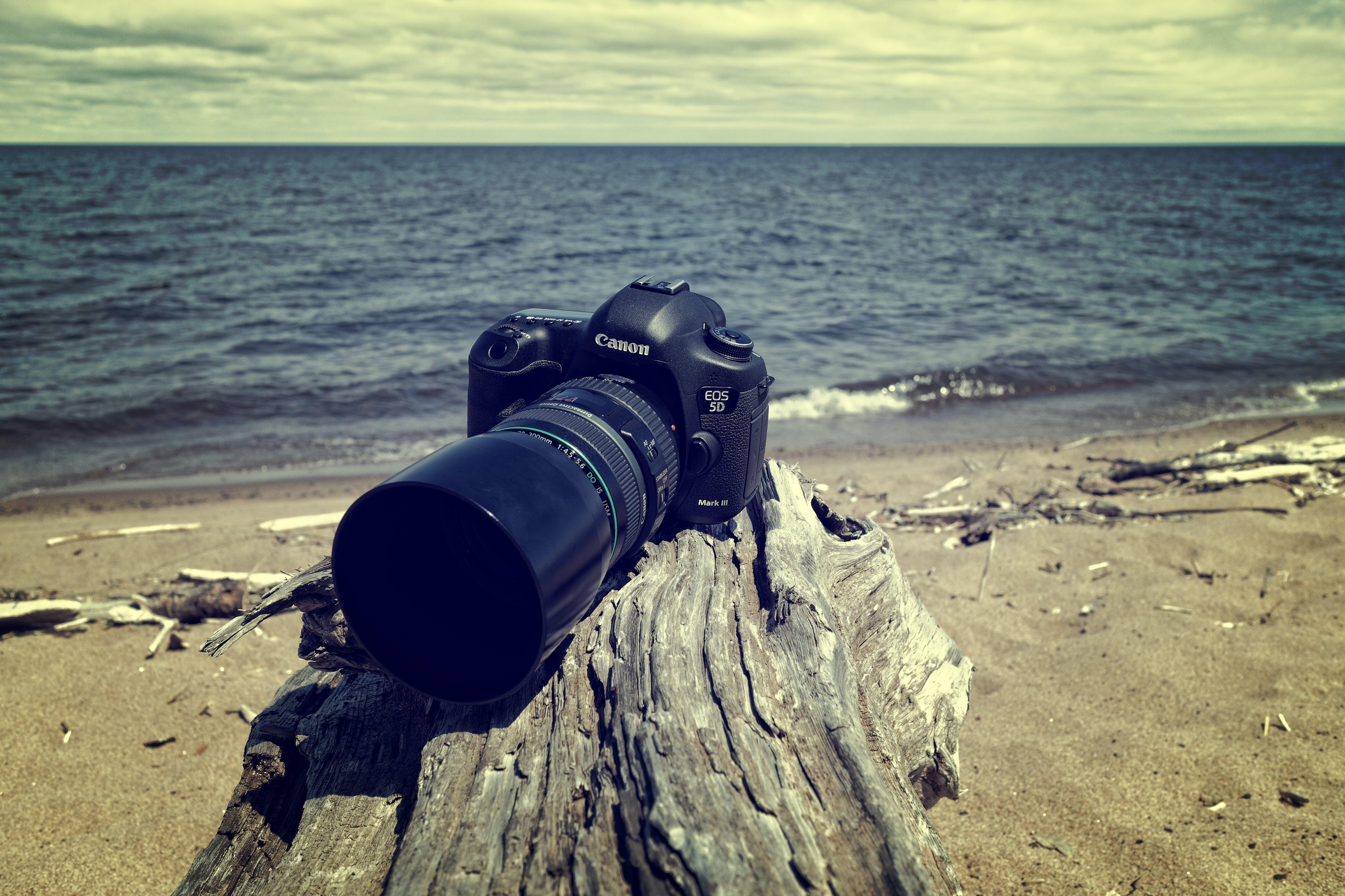 Black Canon Dslr Camera Near Sea Shore