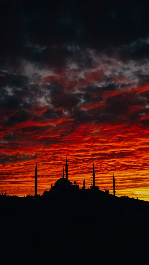 Sunset sky above Blue Mosque silhouette in city