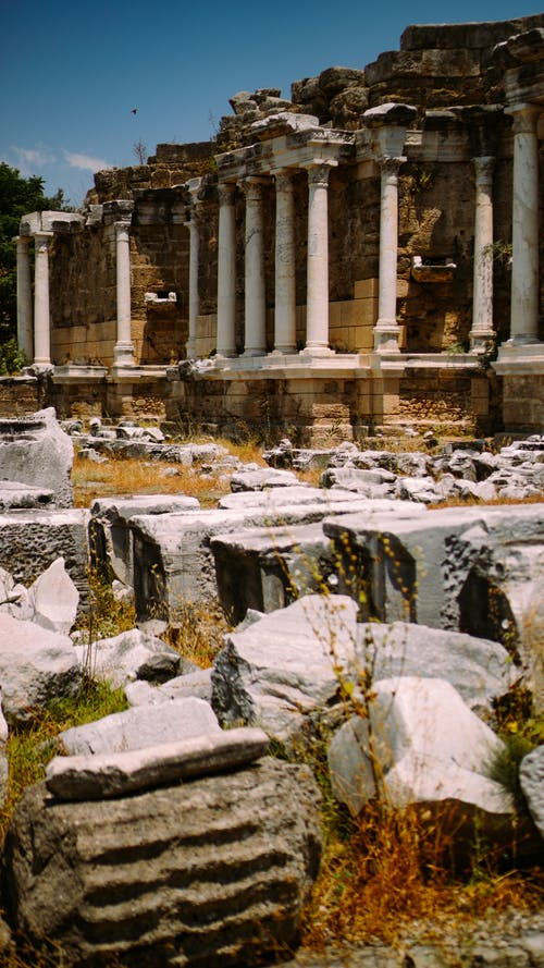Ancient town with Temple of Apollo and stones