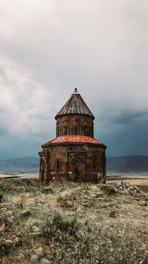 Old abandoned church located in hilly valley