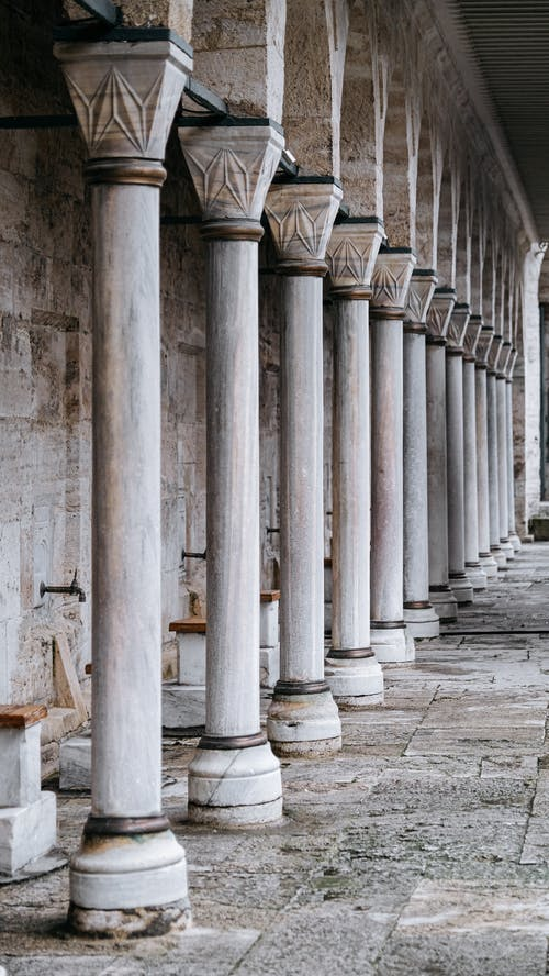 Row of old stone columns of historic building