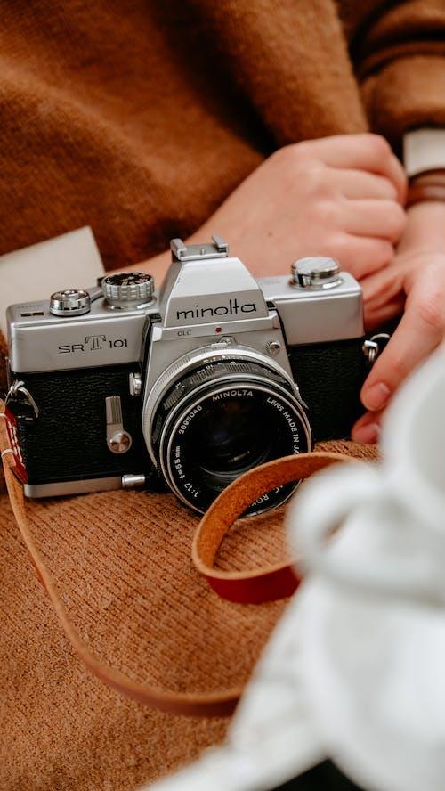 Unrecognizable person with vintage photo camera