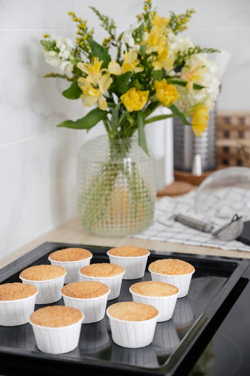 Delicious baked cupcakes on baking tray