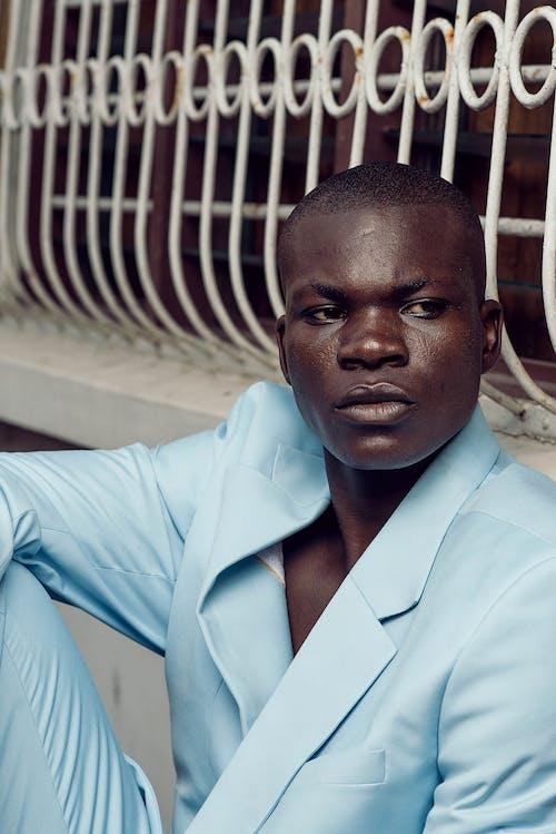 Man in Blue Button Up Shirt
