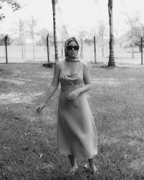 Woman Wearing a Dress Standing on Grass
