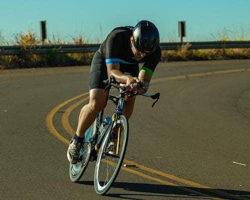 A Male Cyclist Biking on the Road