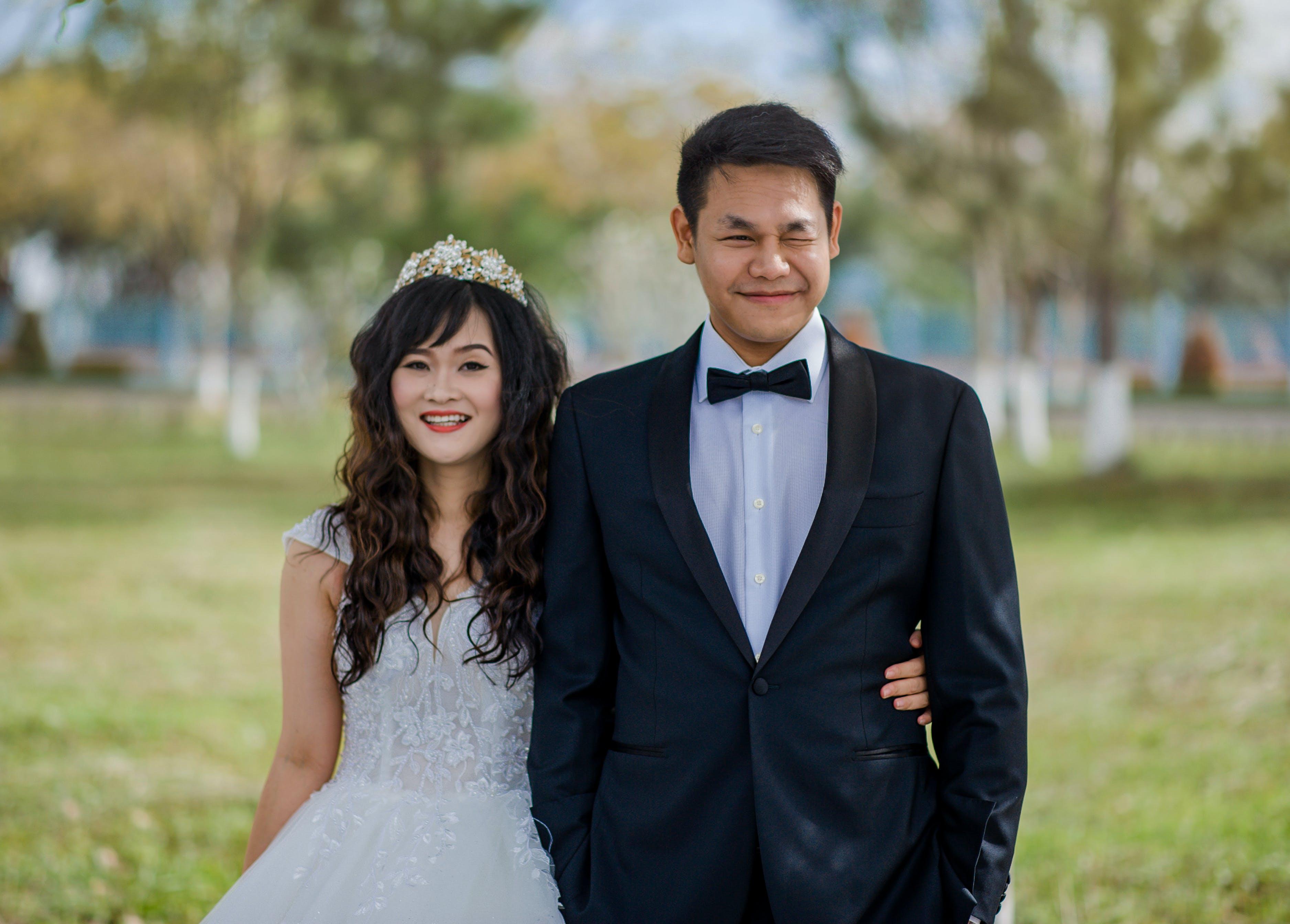 Men Wearing Black Suit Jacket and Woman Wearing White Wedding Gown