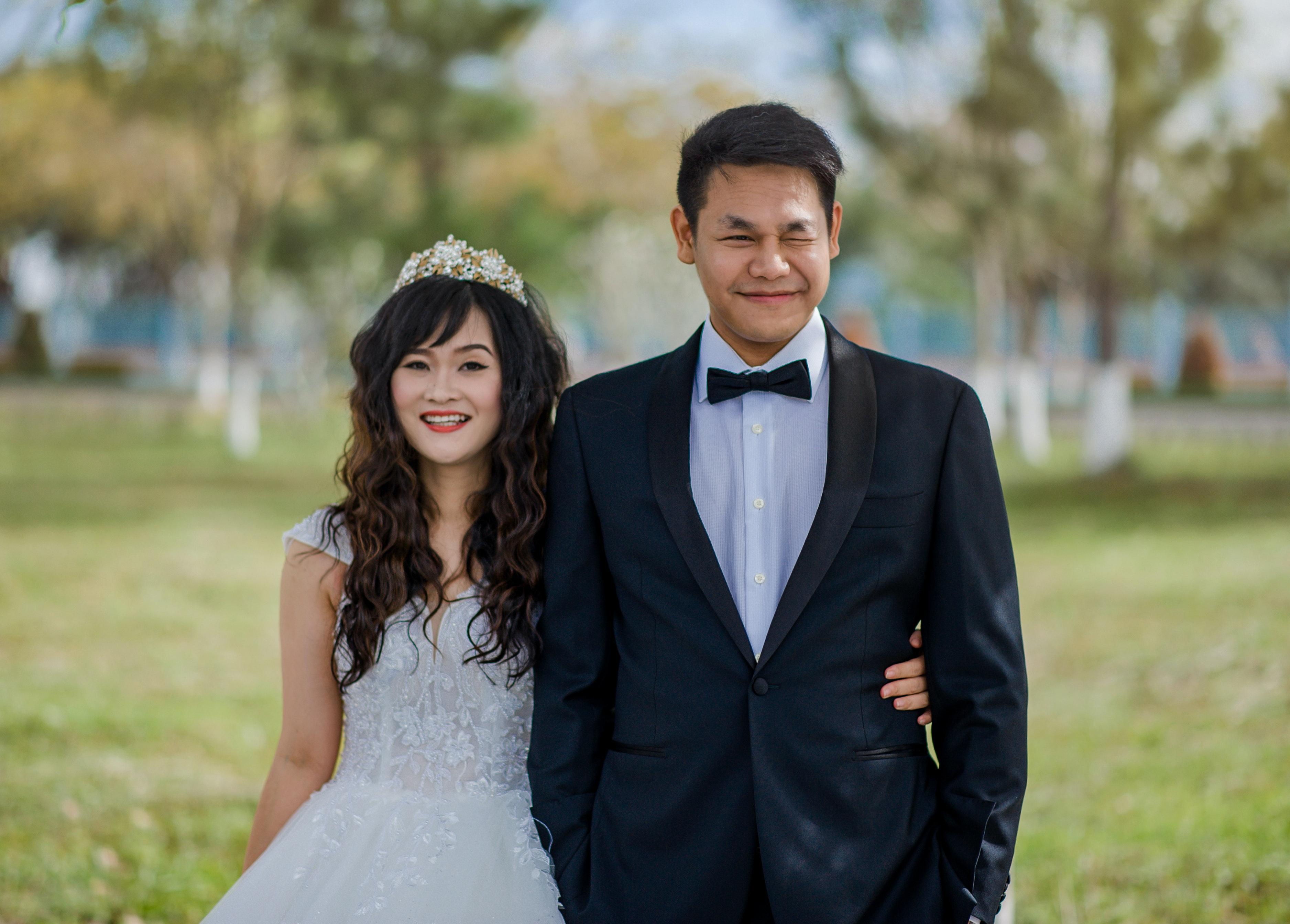 Men Wearing Black Suit Jacket and Woman Wearing White Wedding Gown ...