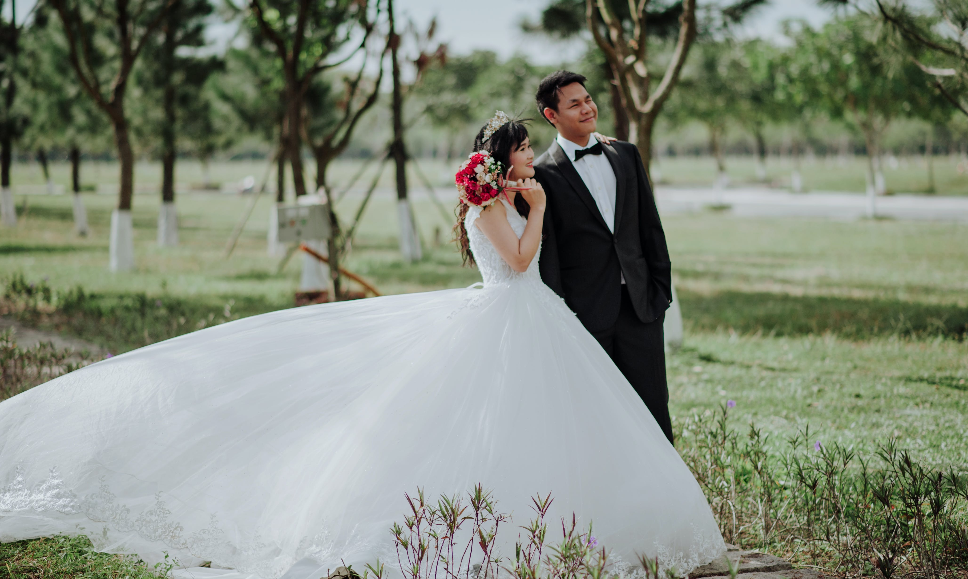 Newly Wed Couple Surrounded by Trees