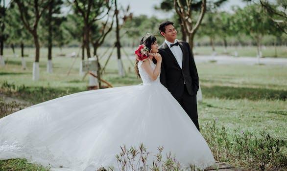 Woman Wearing Wedding Dress Standing Beside a Man Wearing Tuxedo ...