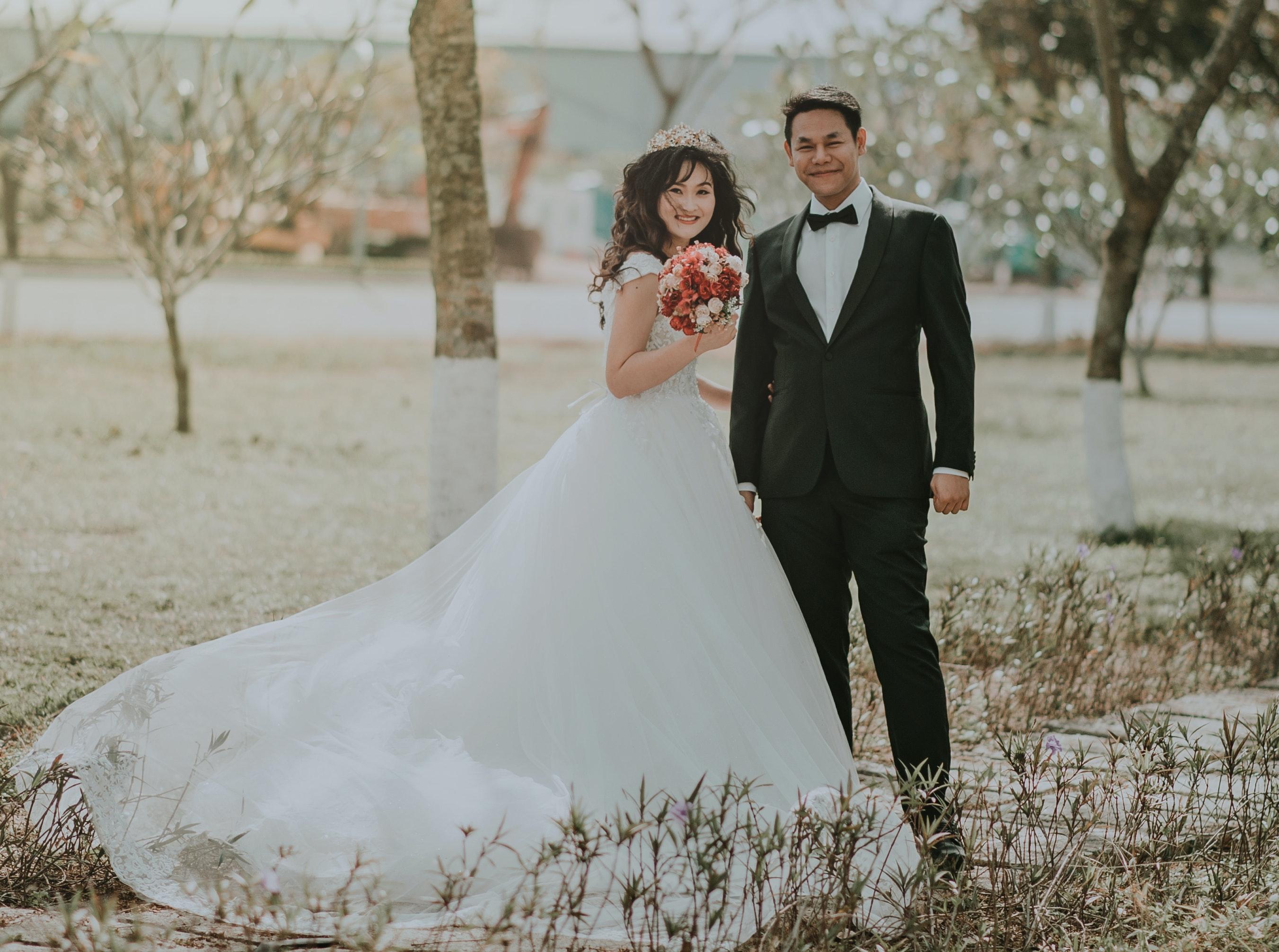 Woman wearing white wedding ball beside man wearing black notch free download junglespirit Choice Image