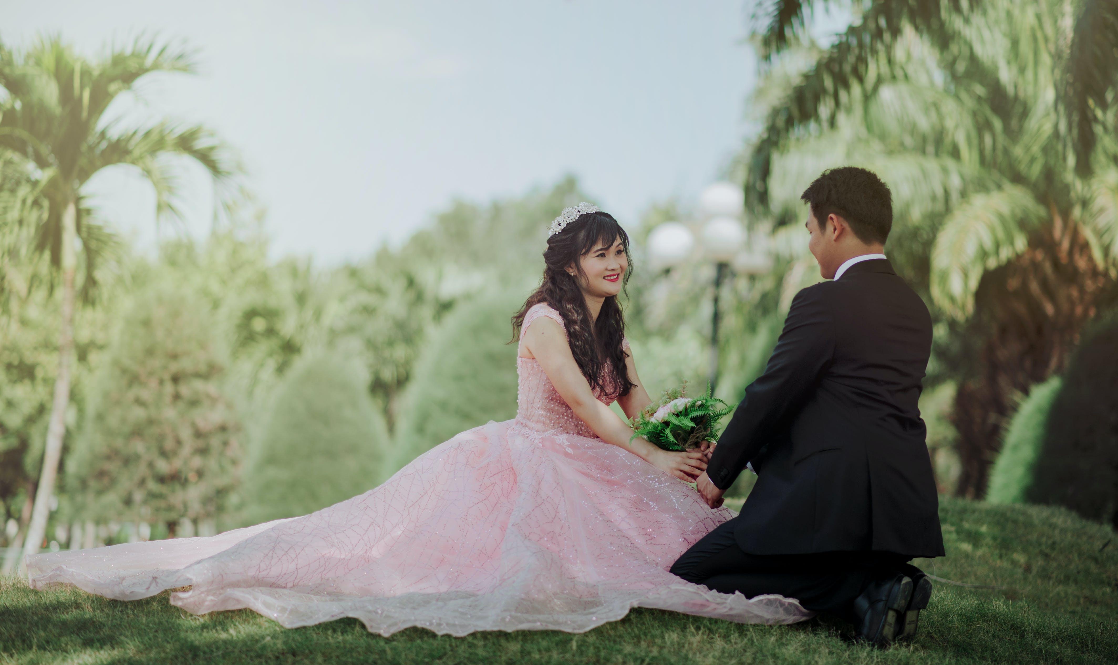 Couple Sitting on Grass