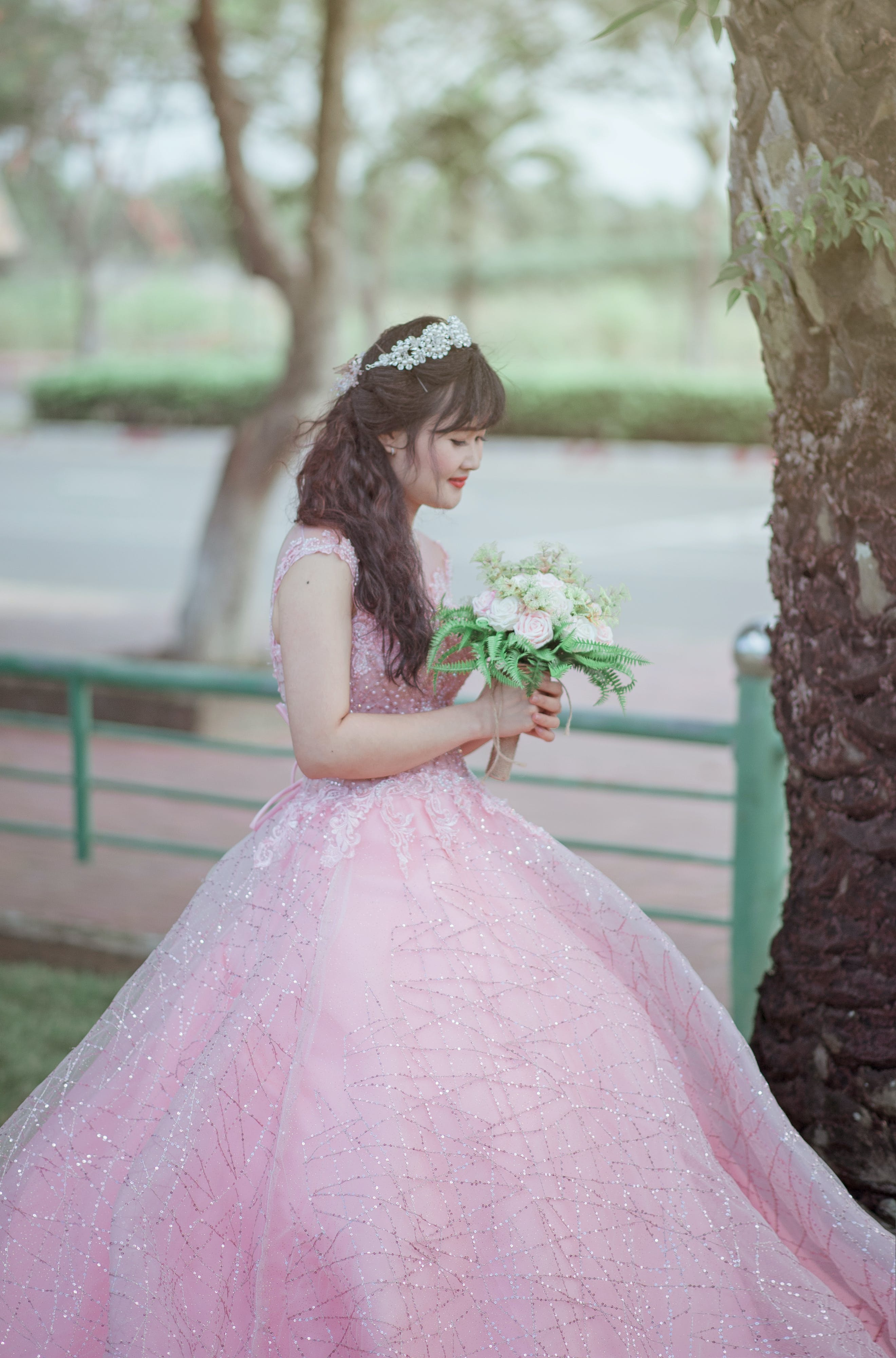 Woman in Pink Sleeveless Gown