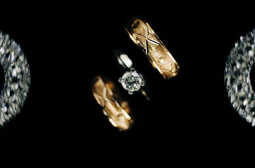 Gold and Diamond Ring on Black Background