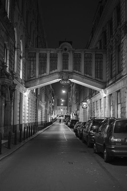 Footbridge between residential buildings on street