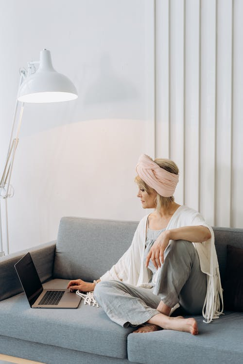 Photo Of A Woman Using Laptop