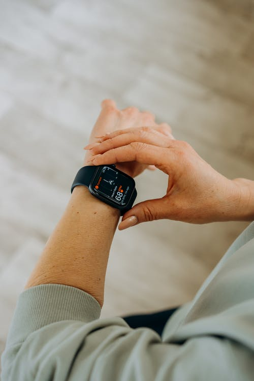 Person Looking at Her Black Smartwatch