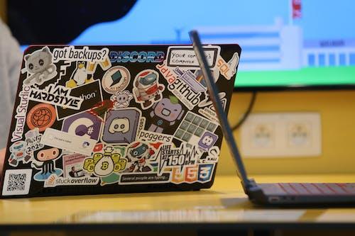 Free stock photo of Discord, Github, laptop