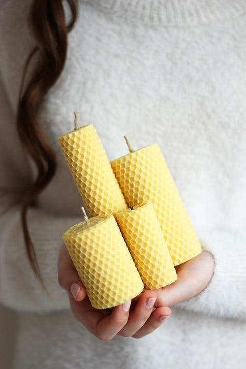 Close-Up Shot of a Person Holding Scented Candles