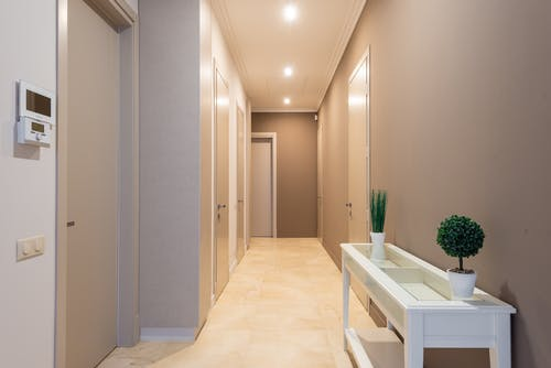 Spacious hallway with gray doors