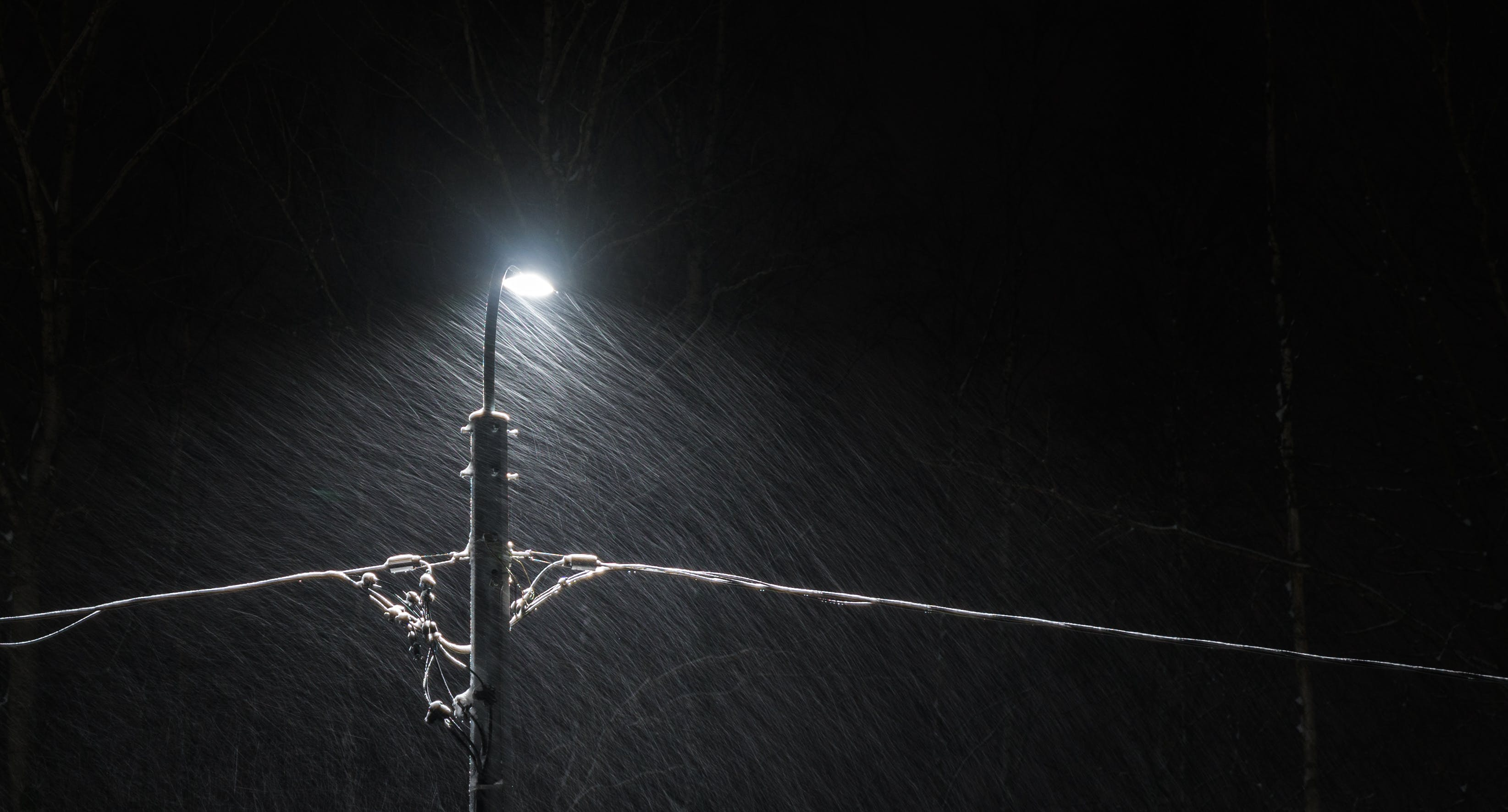 Black Electric Lamp Post With Lighted Lamp during Nighttime