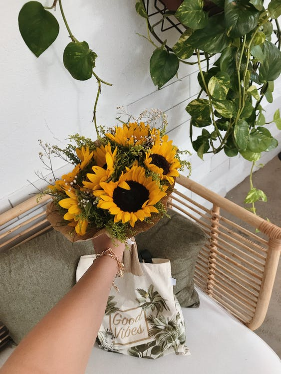 Yellow Sunflower Bouquet on Persons Hand