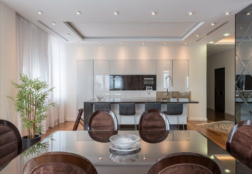Dining room against kitchen zone in modern apartment