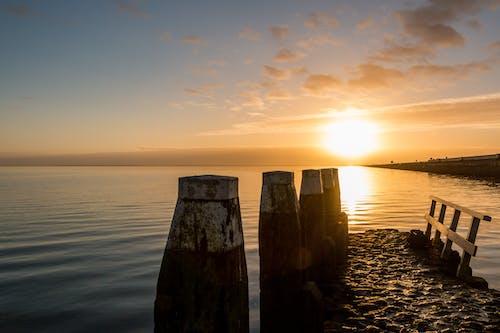 afsluitdijk, akşam Güneşi, altın sarısı, gökyüzü içeren Ücretsiz stok fotoğraf