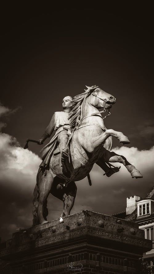 Man Holding Axe Rides On Horse Concrete Statue