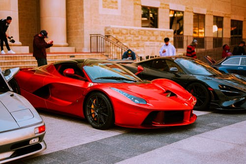 Luxury Cars Parked on the Road