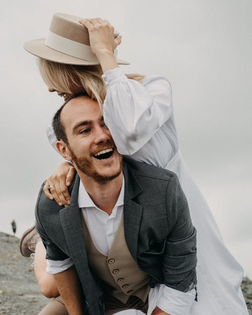 Happy newlywed couple having fun on wedding day