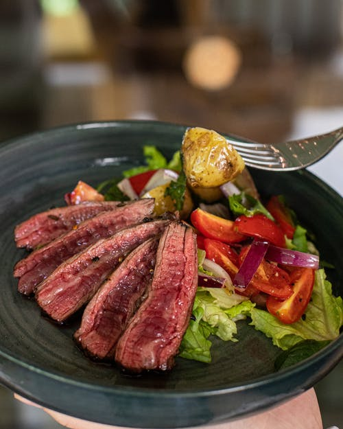 Delicious marbled beef steaks on plate