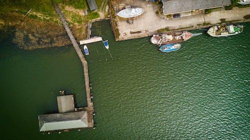 Bird's Eye View of Boat Near Dock on Calm Body of Water