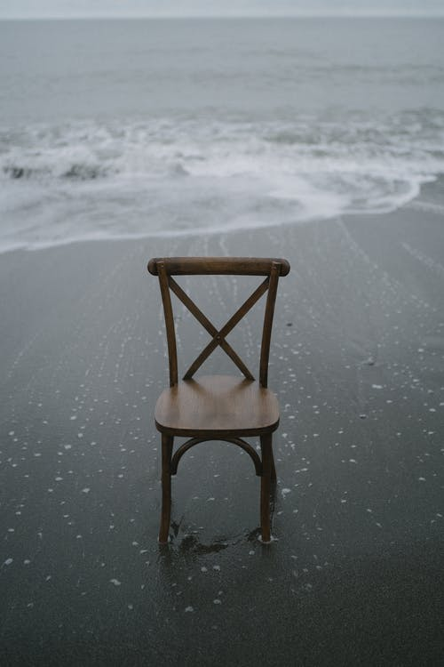 A Brown Wooden Chair on the Seashore