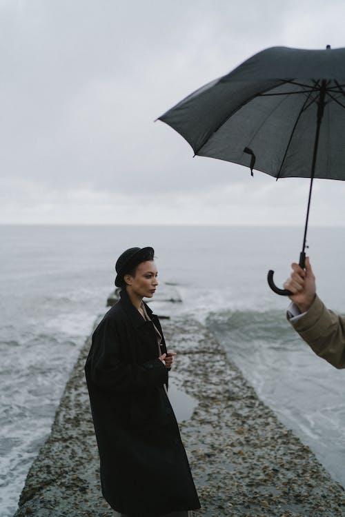 Woman in Black Jacket Holding Umbrella