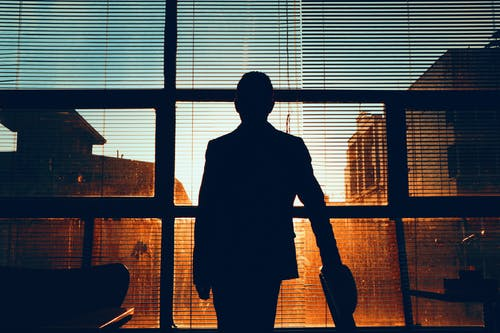 Silhouette of Man  Facing the Window