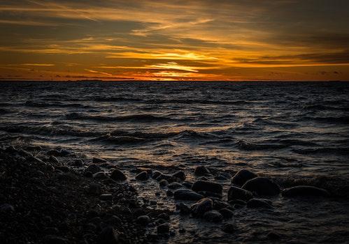 Ocean Waves Near Sea Shore during Sun Set