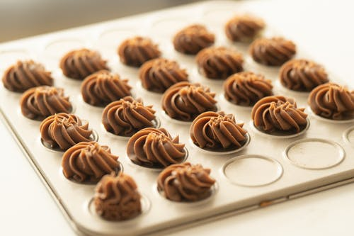Chocolate Coated Cookies on White Ceramic Plate