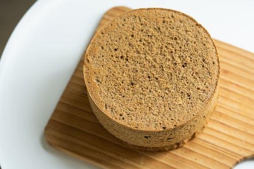 Brown Round Bread on White Plate