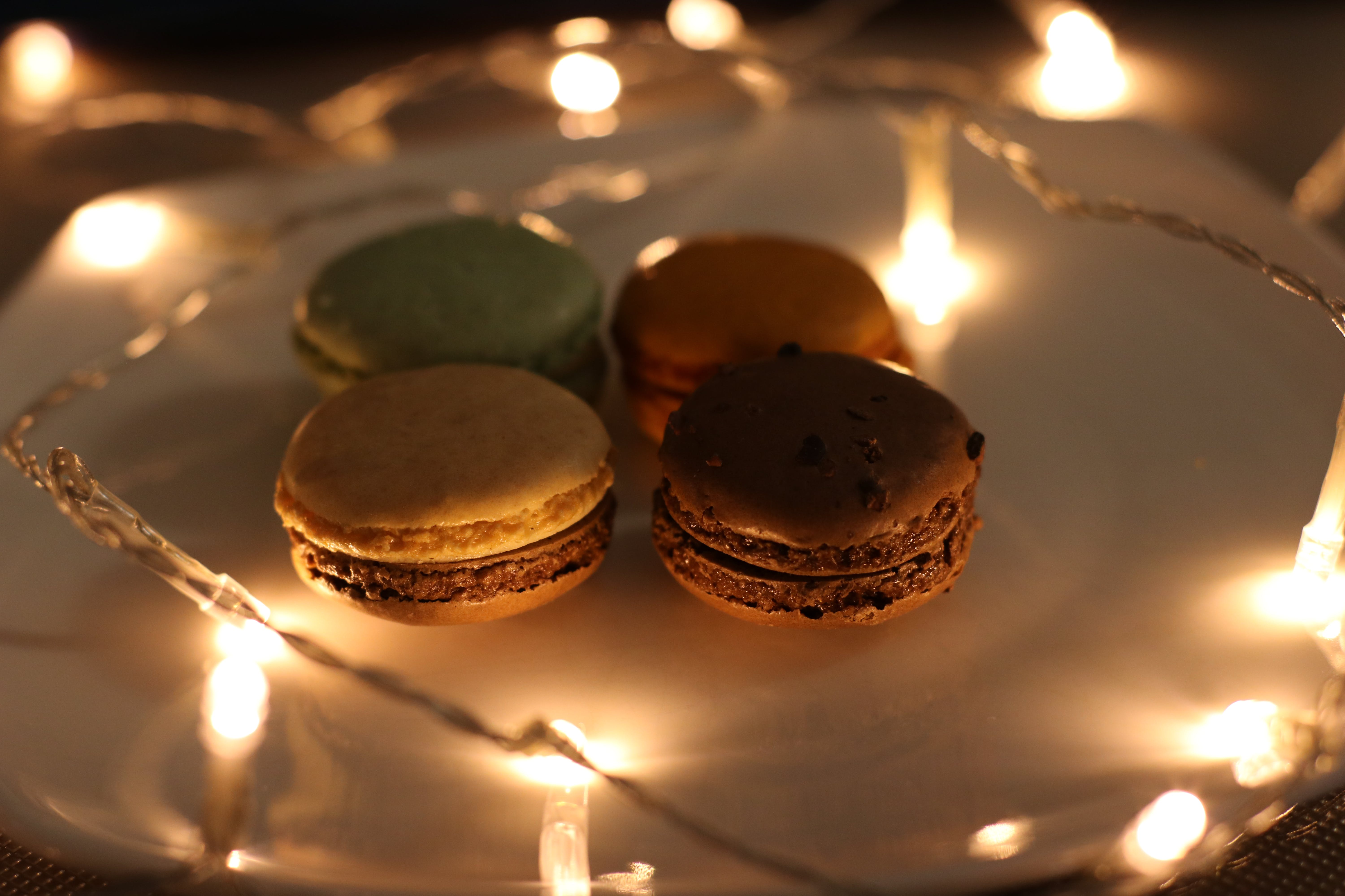 Four Assorted Macaroons on Plate