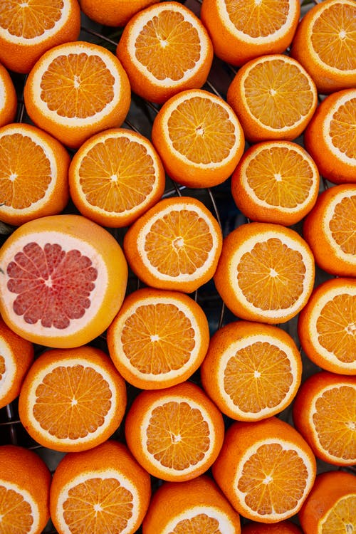 Fresh juicy oranges and grapefruit served on table