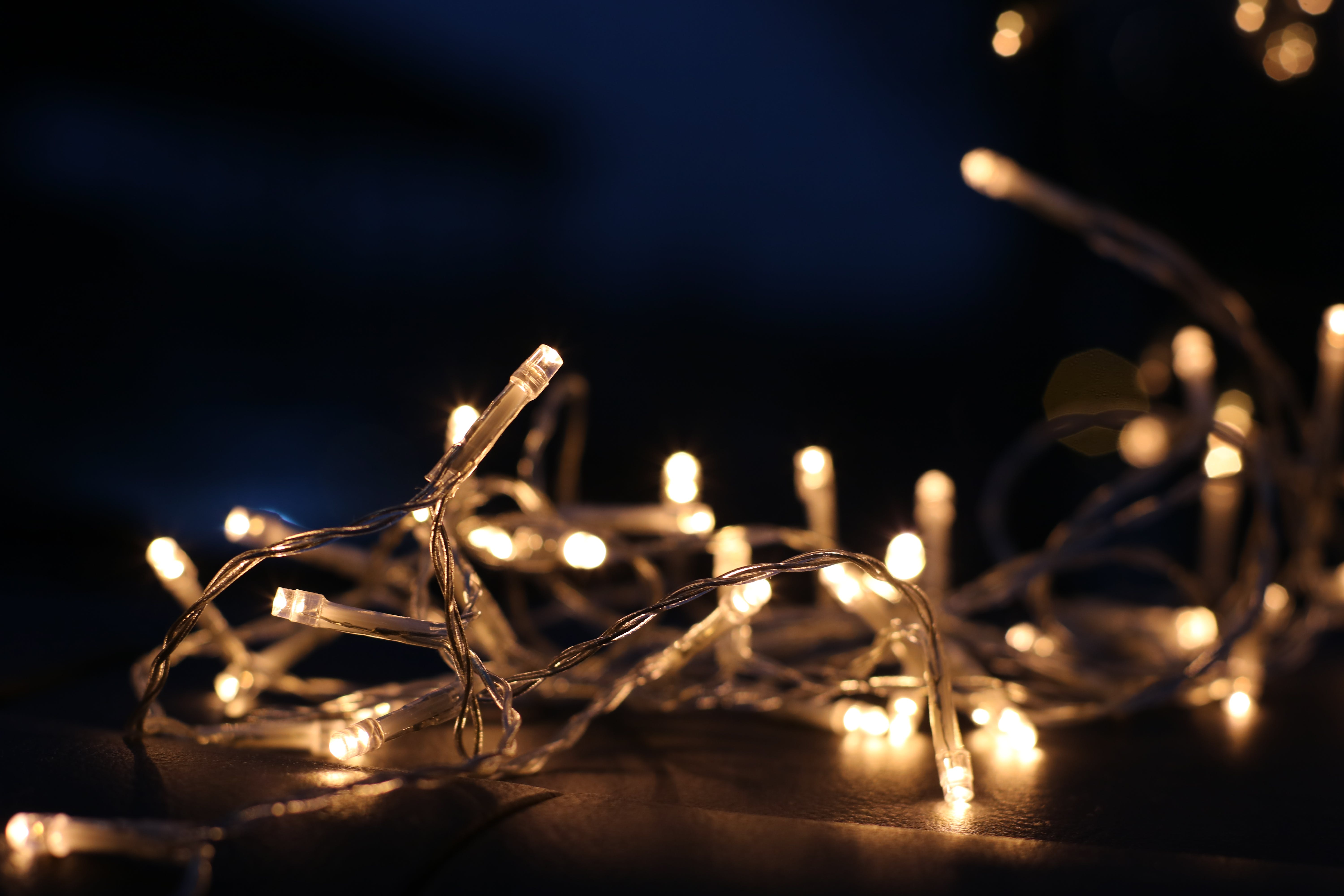 Selective Focus Photo of White and Yellow String Lights