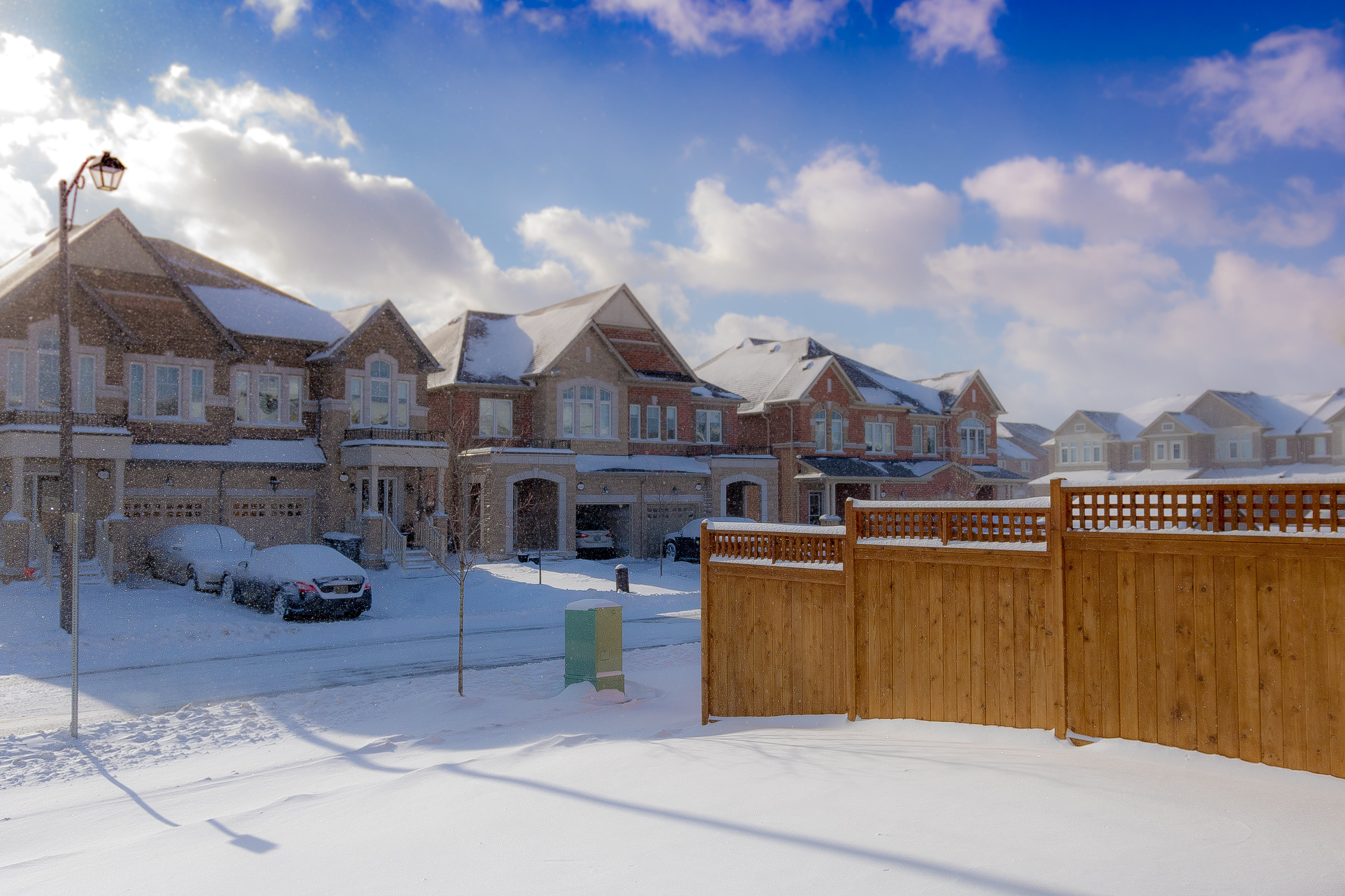 Brown 2-storey Houses during Snow