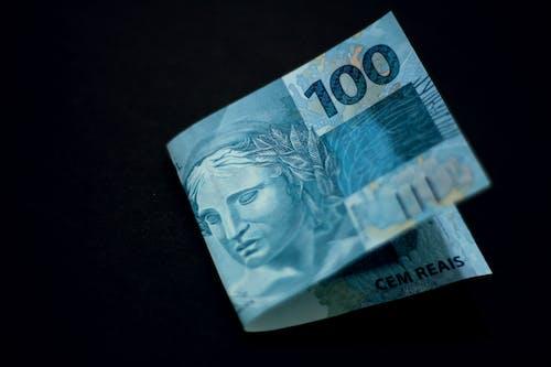 Paper Money on Black Surface
