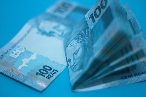 Paper Money on Blue Surface