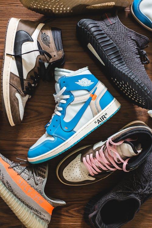 Colorful trendy sneakers on floor