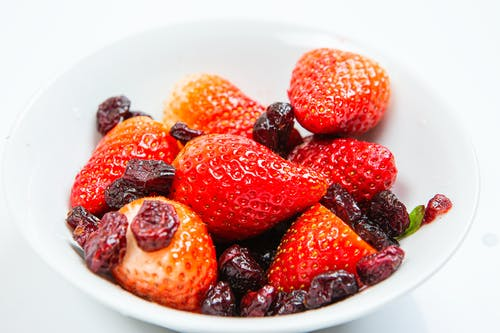 A Bowl of Strawberries and Dried Cranberries