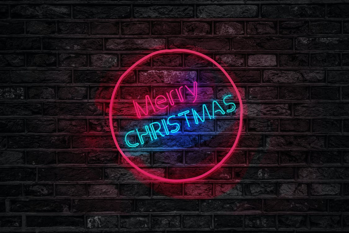 Turned on Red and Blue Merry Christmas Neon Sign